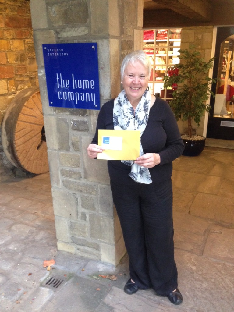Lynda Hall with her voucher from The Home Company